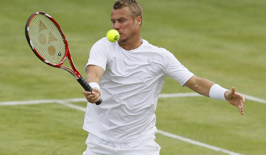 Lleyton Hewitt of Australia plays a return to Kevin Anderson of South Africa during their singles tennis match at the Aegon Championships in London, Monday, June 15, 2015. (AP Photo/Kirsty Wigglesworth)