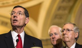 From left: Sen. John Barrasso, Wyoming Republican, accompanied by Senate Majority Whip John Cornyn of Texas and Senate Majority Leader Mitch McConnell of Kentucky, speaks during a news conference on Capitol Hill in Washington on May 5, 2015. (Associated Press) **FILE**