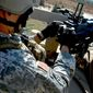 A 3rd Special Forces Group Soldier from the U.S. Army Special Forces Command fires a MK-19 Grenade Launcher during range training on Fort Bragg, N.C. on November 19, 2010. U.S. Army photo by Trish Harris, USASOC PAO