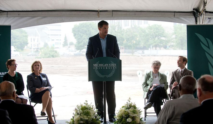 Mitch Lyons, Michigan State University trustee, speaks at a groundbreaking ceremony for the new MSU College of Human Medicine Research Center in Grand Rapids, Mich., on Thursday, June 18, 2015. Michigan State University's new $88.1 million biomedical research center in Grand Rapids will strengthen the area's economic future, school officials said Thursday.  (Emily Rose Bennett/The Grand Rapids Press via AP) ALL LOCAL TELEVISION OUT; LOCAL TELEVISION INTERNET OUT   (Emily Rose Bennett | MLive.com)