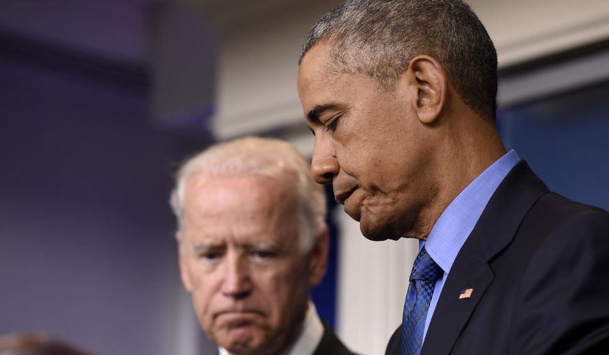 President Barack Obama, accompanied by Vice President Joe Biden, finishes speaking in the Brady Press Briefing Room of the White House in Washington, Thursday, June 18, 2015, on the church shooting in Charleston, S.C., prior to his departure to Los Angeles.  (AP Photo/Susan Walsh)