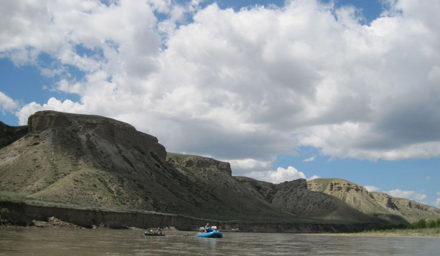 Member of the Montana Chapter of Backcountry Hunters and Anglers head down the Marias River June 6, 2015, near Shelby, Mont.  Access to the river by vehicle is only available in a couple spots, and it was important to the Chapter that it stay that way. (Erin Madison/Great Falls Tribune via AP)  MANDATORY CREDIT