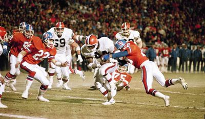 Denver Broncos Jeremiah Castille (28) strips the ball from Cleveland Browns Earnest Byner in the closing minutes of the AFC Championship game in Denver Sunday, Jan. 17, 1988 to get the ball for the Broncos who won the game in the losing seconds, 38-33. (AP Photo/Mark Duncan)