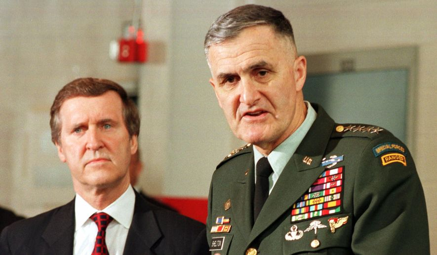 Joint Chiefs Chairman, Gen. Hugh Shelton, right, gestures as Sec. of Defense, William Cohen, brief the press at the Norfolk Naval Base in Norfolk, Va., Thursday April 1, 1999.   (AP Photo/Steve Helber)