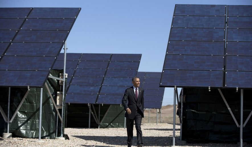 FILE - In this April 3, 2015 file photo, President Barack Obama walks through a solar array at Hill Air Force Base, Utah, to speak about clean energy. The growth of renewable energy outpaced that of fossil fuels in the electricity sector last year, with a record 135 gigawatts of capacity added from wind, solar, hydropower and other natural sources, a new study shows. The annual report released early Thursday, June 18, 2015 in Europe by Paris-based REN21, a non-profit group that promotes renewable energy, underscored how China, the world's top consumer of coal, has become a global leader in clean energy, too. (AP Photo/Carolyn Kaster, File)