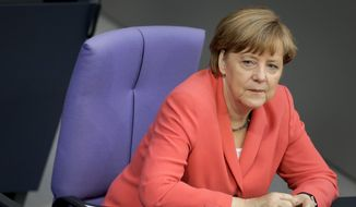 German Chancellor Angela Merkel listens to a debate of the German federal parliament, Bundestag, in Berlin, Germany, Thursday, June 18, 2015. (AP Photo/Michael Sohn) ** FILE **
