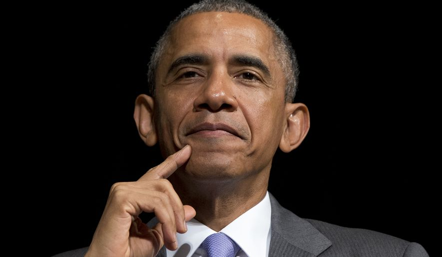 In this June 17, 2015, photo, President Barack Obama looks out as he sits on stage as Attorney General Loretta Lynch speaks during her investiture ceremony at the Warner Theatre in Washington. Critics have long predicted that Obama's policy to shift America's focus toward Asia is doomed. The legislative battle over his trade agenda could prove the acid test.  (AP Photo/Carolyn Kaster)