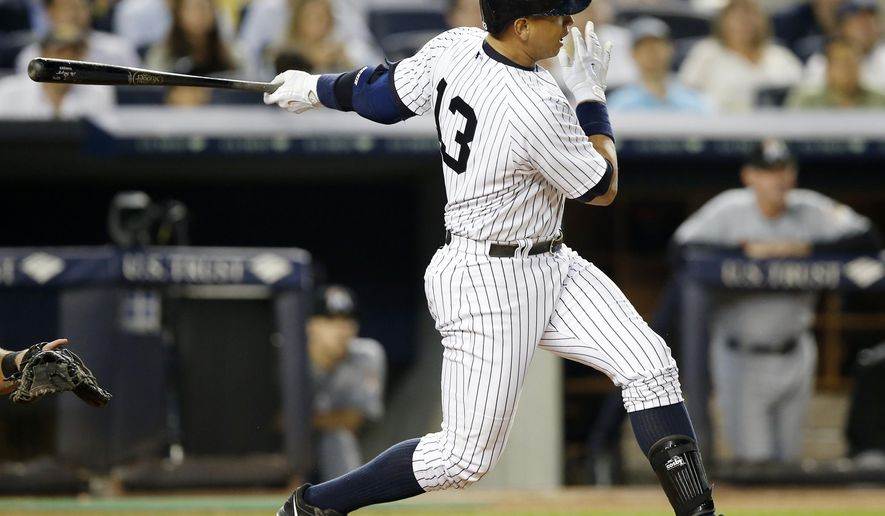 New York Yankees designated hitter Alex Rodriguez follows through on his 2,999th career hit in the fifth inning of a baseball game against the Miami Marlins at Yankee Stadium in New York, Thursday, June 18, 2015.  (AP Photo/Kathy Willens)
