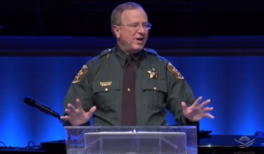 Sheriff Grady Judd of Polk County, Florida, has refused to back down after an atheist group complained he violated the First Amendment by giving a church sermon in his law enforcement uniform. (Screengrab via churchatthemall.com) ** FILE **