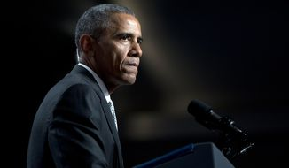 President Barack Obama pauses as he speaks about gun violence at the Annual Meeting of the U.S. Conference of Mayors in San Francisco, Friday, June 19, 2015. (AP Photo/Carolyn Kaster)