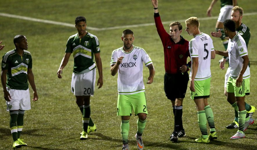 In this photo taken Tuesday, June 16, 2015, Seattle Sounders FC's forward Clint Dempsey (2) appears to rip up referee Daniel Radford's notebook after Radford issued a red card to teammate Michael Ariza while playing the Portland Timbers in a U.S. Open Cup soccer match at Starfire Stadium in Tukwila, Wash. Dempsey was issued a red card his actions. (Erika Schultz/The Seattle Times via AP) SEATTLE OUT; USA TODAY OUT; MAGS OUT; TELEVISION OUT; NO SALES; MANDATORY CREDIT TO BOTH THE SEATTLE TIMES AND THE PHOTOGRAPHER