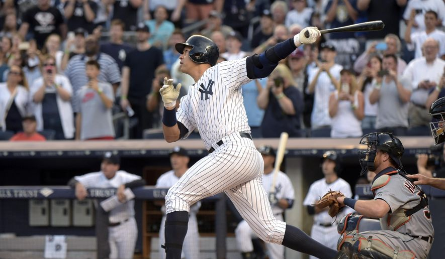 New York Yankees' Alex Rodriguez follows through on a home run during the first inning of a baseball game against the Detroit Tigers on Friday, June 19, 2015, at Yankee Stadium in New York. The home run was his 3,000th career hit. (AP Photo/Bill Kostroun)