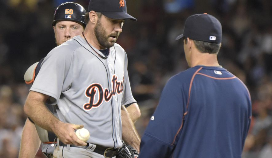 Detroit Tigers pitcher Justin Verlander, left, hands the ball to manager Brad Ausmus as he comes out of the baseball game in the seventh inning against the New York Yankees on Friday, June 19, 2015, at Yankee Stadium in New York. (AP Photo/Bill Kostroun)