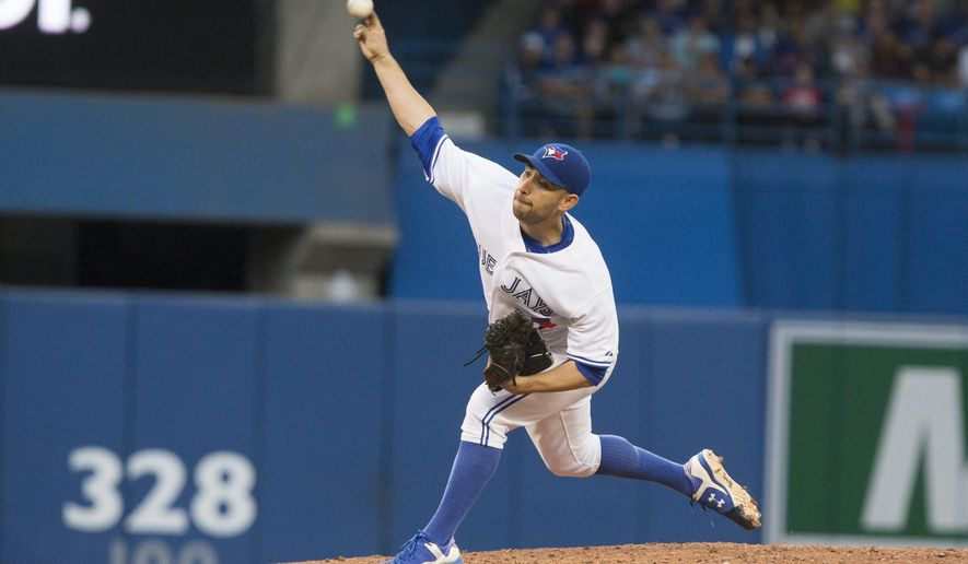 Toronto Blue Jays starting pitcher Marco Estrada throws against the Baltimore Orioles during third-inning baseball game action in Toronto, Friday June 19, 2015. (Chris Young/The Canadian Press via AP) MANDATORY CREDIT