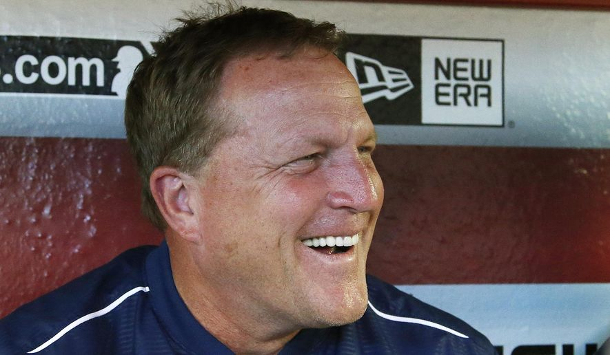 New San Diego Padres baseball manager Pat Murphy laughs as he talks with reporters in the team dugout prior a baseball game against the Arizona Diamondbacks, Friday, June 19, 2015, in Phoenix. Murphy was the former head coach for the Arizona State baseball team. (AP Photo/Ross D. Franklin)