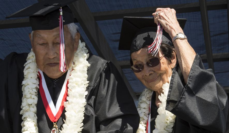 George Kaihara and his wife Miko Nakamura Kaihara, both 90-years-old,  join other graduates during the tassel ceremony at the Tustin High School commencement ceremony in Tustin, Calif., Thursday, June 18, 2015.  George and Miko were juniors at the school when the Japanese bombed Pearl Harbor, and they were sent to Poston internment camp in Arizona. Dennis Hayden, a classmate of George and Miko from 72-years-ago, recently reconnected with them, and made it his mission to see them graduate.  (Ed Crisostomo/The Orange County Register via AP)   MAGS OUT; LOS ANGELES TIMES OUT; MANDATORY CREDIT