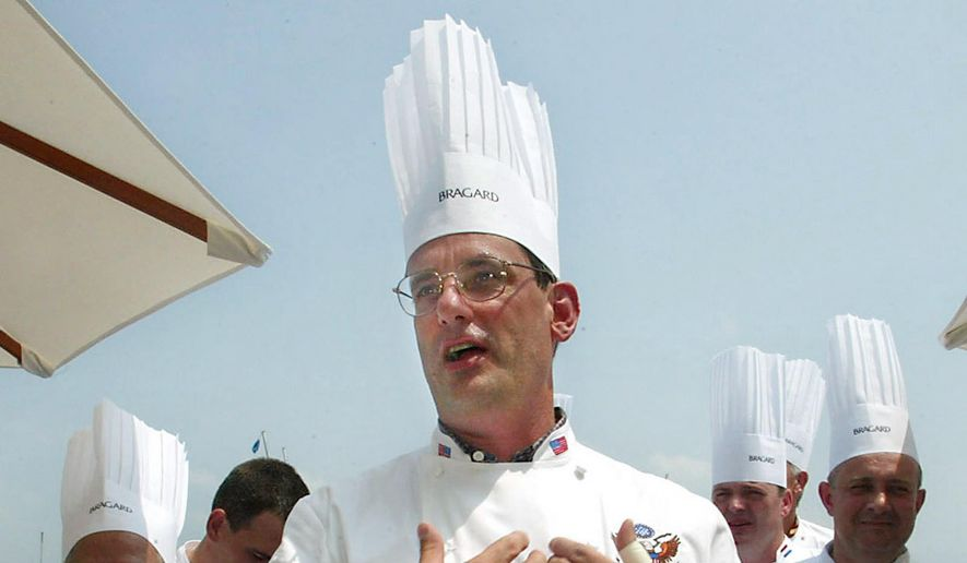 In this July 27, 2004, file photo, outgoing White House chef Walter Scheib greets chefs from around the world at the Chesapeake Bay Maritime Museum in St. Michaels, Md. (AP Photo/Matt Houston, Files)