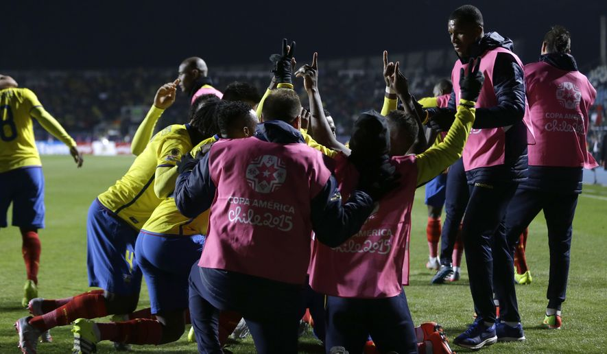 Ecuador players celebrate after scoring their second goal during a Copa America Group A soccer match against Mexico at El Teniente Stadium in Rancagua, Chile, Friday, June 19, 2015. Ecuador won the match 2-1.(AP Photo/Ricardo Mazalan)