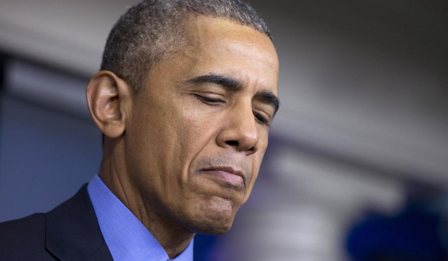 President Barack Obama pauses while speaking in the Brady Press Briefing Room of the White House in Washington, Thursday, June 18, 2015, on the church shooting in Charleston, S.C., prior to his departure to Los Angeles. (AP Photo/Manuel Balce Ceneta)