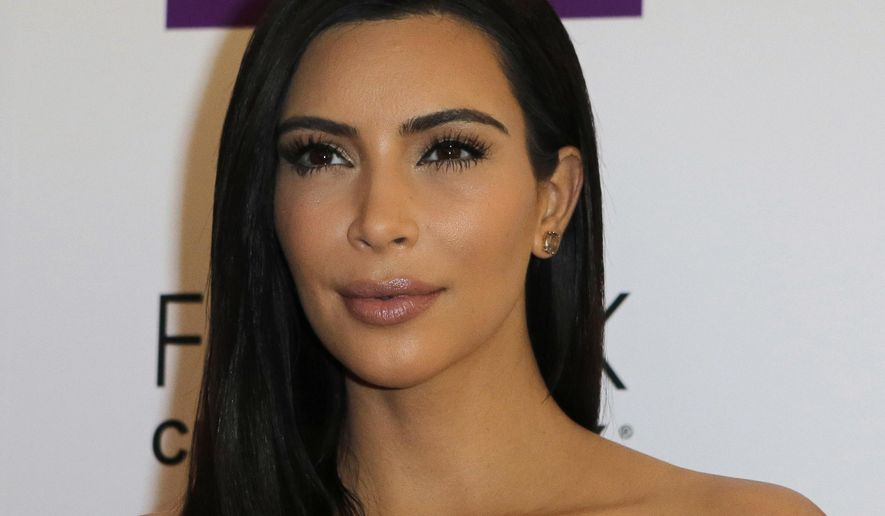 "FILE - In this April 15, 2015,  file photo, Kim Kardashian attends a photocall to launch hair products in Paris. An appearance by Kim Kardashian on the National Public Radio show ""Wait Wait ... Don't Tell Me!"" has angered some listeners. Some have threatened to stop donating to the nonprofit NPR. (AP Photo/Jacques Brinon, File)"