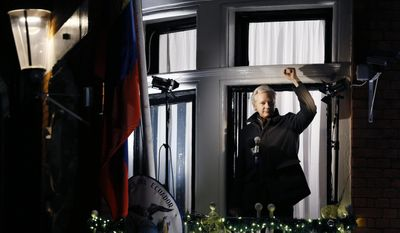 In this Thursday, Dec. 20, 2012, file photo, Julian Assange, founder of WikiLeaks gestures as he speaks to the media and members of the public from a balcony at the Ecuadorian Embassy in London.. (AP Photo/Kirsty Wigglesworth, File)