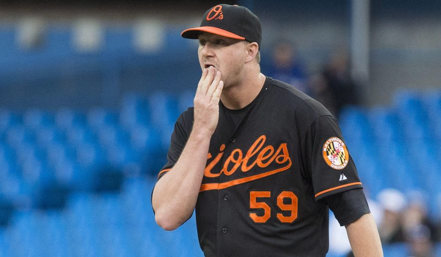 Baltimore Orioles starting pitcher Mike Wright stands on the mound as he works against Toronto Blue Jays during first-inning baseball game action in Toronto, Friday June 19 , 2015. (Chris Young/The Canadian Press via AP) MANDATORY CREDIT