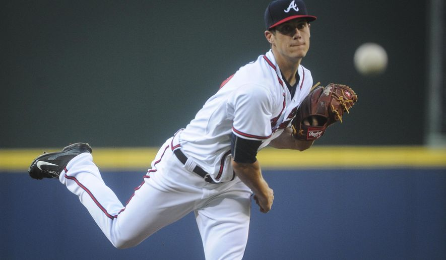 Atlanta Braves' Matt Wisler delivers a pitch against the New York Mets during his MLB debut in the first inning of a baseball game, Friday, June 19, 2015, in Atlanta. (AP Photo/John Amis )
