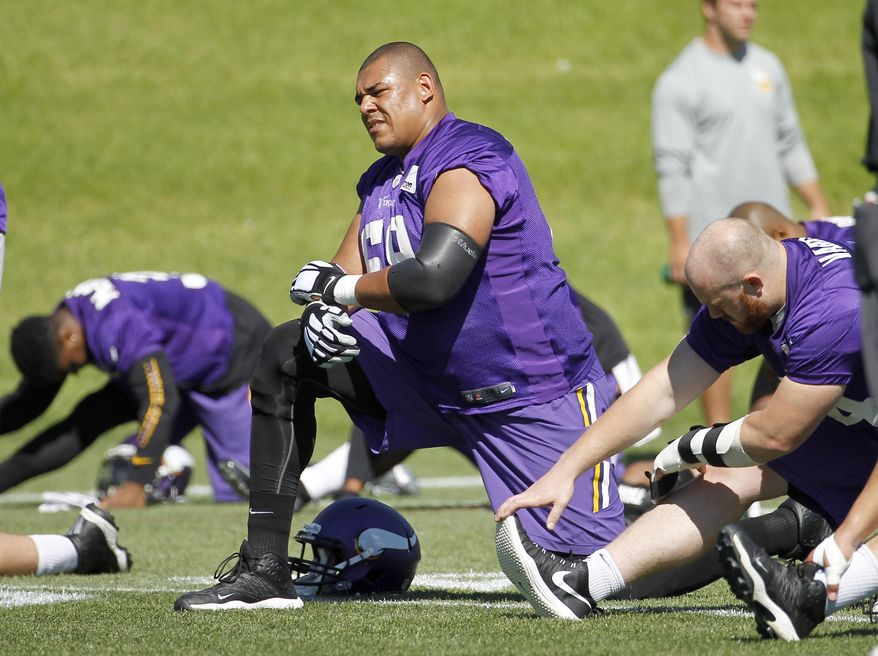 Minnesota Vikings tackle Babatunde Aiyegbusi stretches with teammates during NFL football minicamp in Eden Prairie, Minn., Tuesday, June 16, 2015. (AP Photo/Ann Heisenfelt)