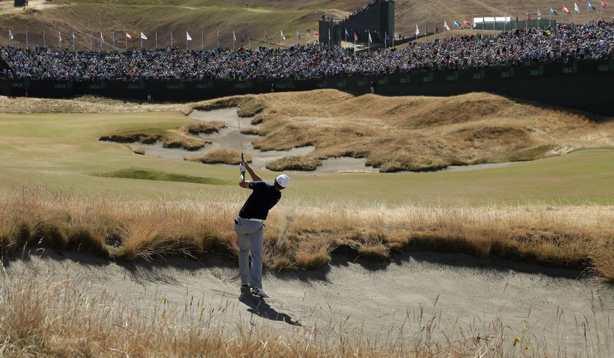 Jordan Spieth hits out of a bunker on the 18th hole during the second round of the U.S. Open golf tournament at Chambers Bay on Friday, June 19, 2015 in University Place, Wash. (AP Photo/Charlie Riedel)