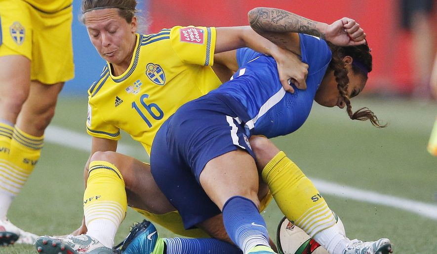 FILE - In this June 12, 2015, file photo, Sweden's Lina Nilsson (16) hauls down United States' Sydney Leroux (2) during second-half FIFA Women's World Cup soccer game action in Winnipeg, Manitoba, Canada. Sweden drew Group D, the so-called Group of Death, with the United States, Australia and Nigeria. The path certainly doesn't get any easier for coach Pia Sundhage's fifth-ranked team, who will face top-ranked Germany to open the knockout stage at the Women's World Cup.  (John Woods/The Canadian Press via AP, File) MANDATORY CREDIT