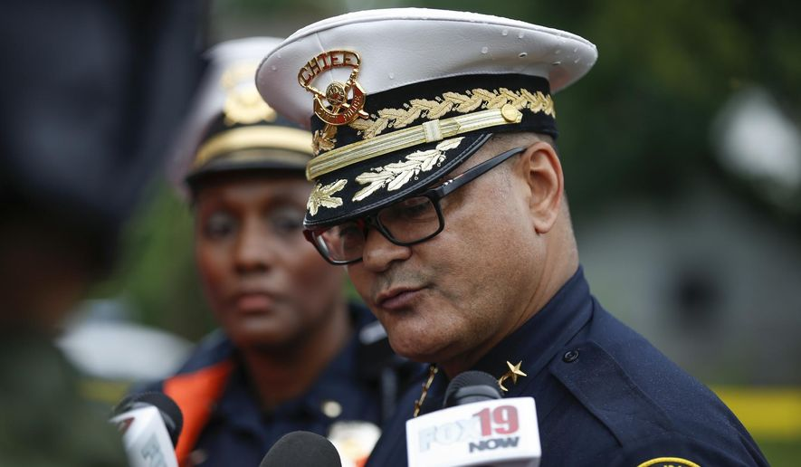 Cincinnati Chief of Police Jeffery Blackwell speaks to the media at the scene of the shooting on Friday, June 19, 2015 in Cincinnati. Blackwell says a veteran policeman and an armed person who exchanged gunfire with officers have died.   The officer was identified as 48-year-old Sonny Kim, a 27-year veteran of the department. (Madison Schmidt/The Cincinnati Enquirer via AP)  MANDATORY CREDIT;  NO SALES