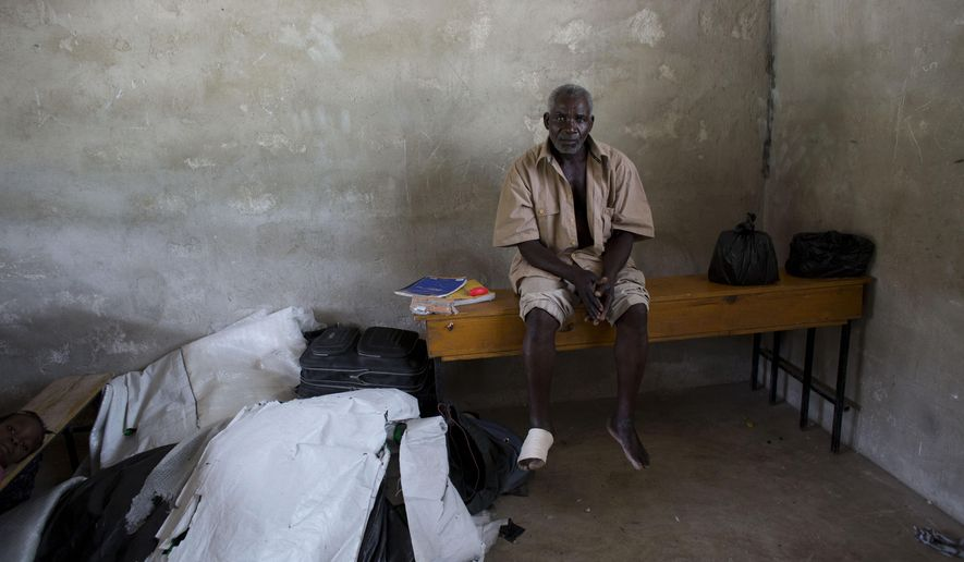 Andre Joseph, 53, who says he was born in the Dominican Republic and lived there until being deported the day before, sits inside a school classroom where residents have allowed him and other deportees to sleep in the village of Fonbaya, Haiti, Thursday, June 18, 2015. Thousands of people began preparing Thursday for deportation from the Dominican Republic after failing to obtain legal residency as part of a government program to crack down on migrants, most of them from neighboring Haiti or of Haitian descent. (AP Photo/Rebecca Blackwell)