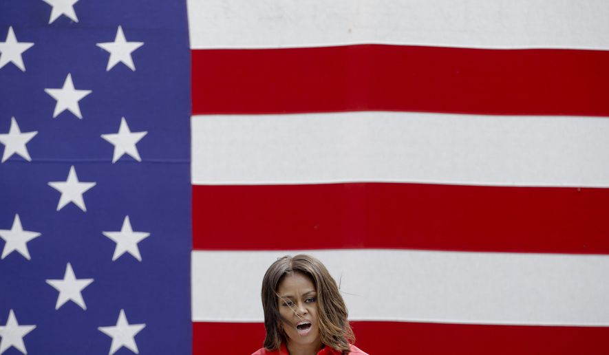 U.S. first lady Michelle Obama delivers her speech as she meets with soldiers and their families at the U.S. Army Garrison Vicenza, northern Italy, Friday, June 19, 2015. Michelle Obama, who is visiting Italy on the second leg of a European trip, thanked the U.S. soldiers and their families for their service. (AP Photo/Antonio Calanni)