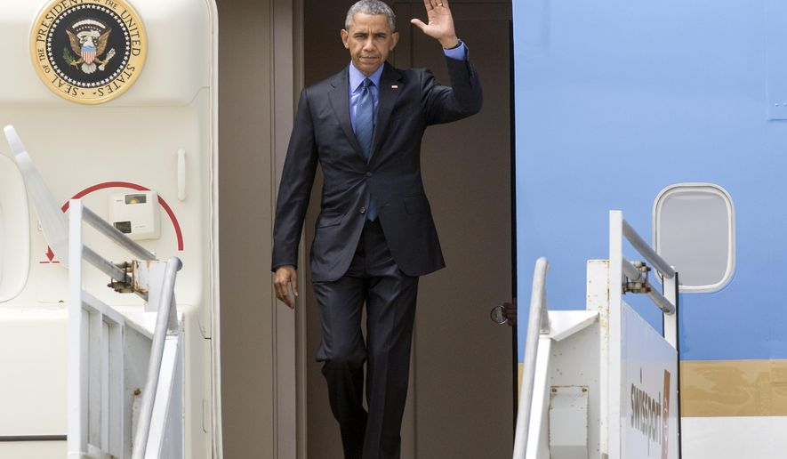 President Barack Obama steps out of  Air Force One at Los Angeles International airport on Thursday, June 18, 2015. (AP Photo/Damian Dovarganes)