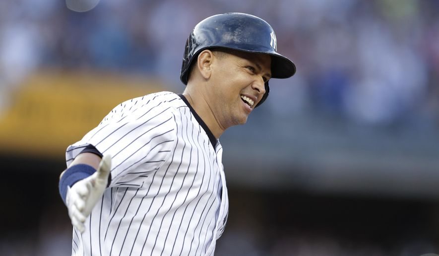 New York Yankees' Alex Rodriguez smiles after hitting a home run for his 3,000th career hit, during the first inning of a baseball game against the Detroit Tigers on Friday, June 19, 2015, in New York. (AP Photo/Frank Franklin II)