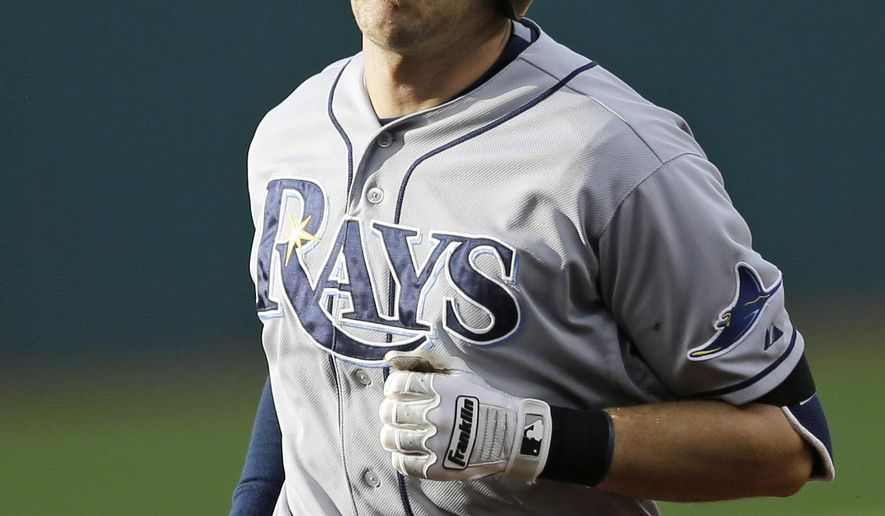 Tampa Bay Rays' Evan Longoria runs the bases after hitting a three-run home run off Cleveland Indians starting pitcher Corey Kluber in the first inning of a baseball game, Saturday, June 20, 2015, in Cleveland. Kevin Kiermaier and Joey Butler also scored on the play. (AP Photo/Tony Dejak)