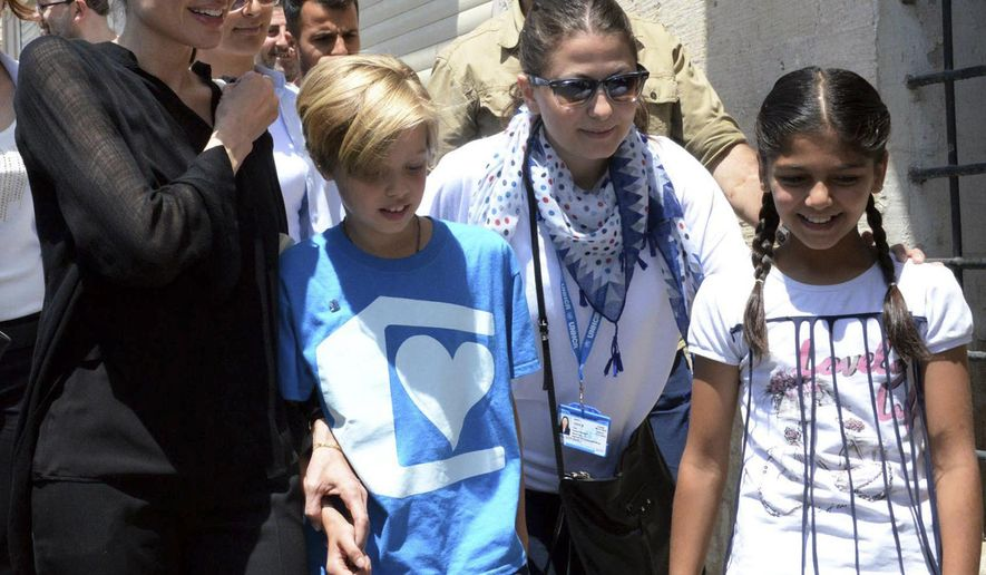 U.S. actress Angelina Jolie, left, Special Envoy of the United Nations High Commissioner for Refugees, and her daughter Shiloh, second left, walk, in the city of Mardin, southeastern Turkey, Saturday, June 20, 2015. Jolie will visit the Mardin Midyat refugee camp near the Syrian border, which is  sheltering those who have fled the 4-year conflict in neighbouring Syria. The UN refugee agency has said the number of Syrian refugees seeking its help now tops two-million - and could be far higher. Turkey is the world's biggest refugee host with 1.59 million refugees, according to the most recent U.N. figures. (AP Photo)