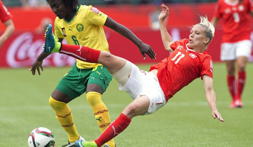 Switzerland's Lara Dickenmann (11) and Cameroon's Francine Zouga (6) battle for the ball during the second half of a FIFA Women's World Cup soccer match, Tuesday, June 16, 2015 in Edmonton, Alberta, Canada. (Jason Franson/The Canadian Press via AP) MANDATORY CREDIT