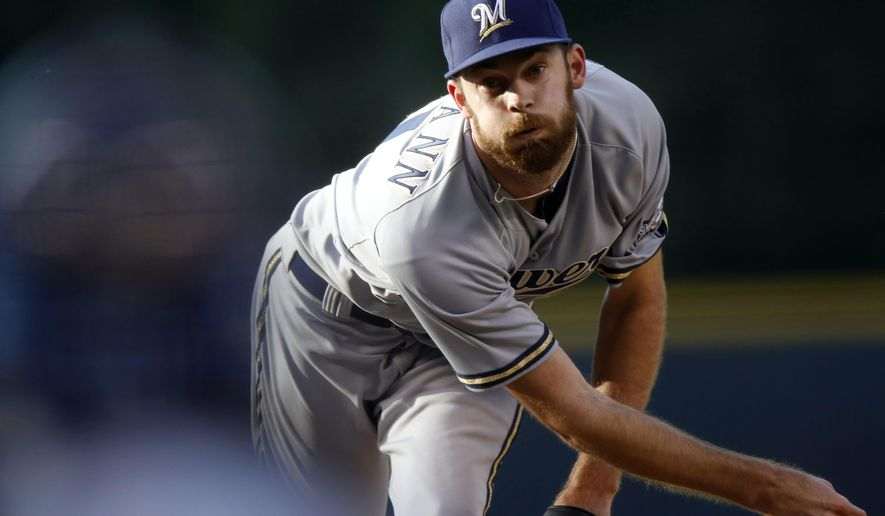 Milwaukee Brewers starting pitcher Taylor Jungmann works against the Colorado Rockies in the first inning of a baseball game Friday, June 19, 2015, in Denver. (AP Photo/David Zalubowski)