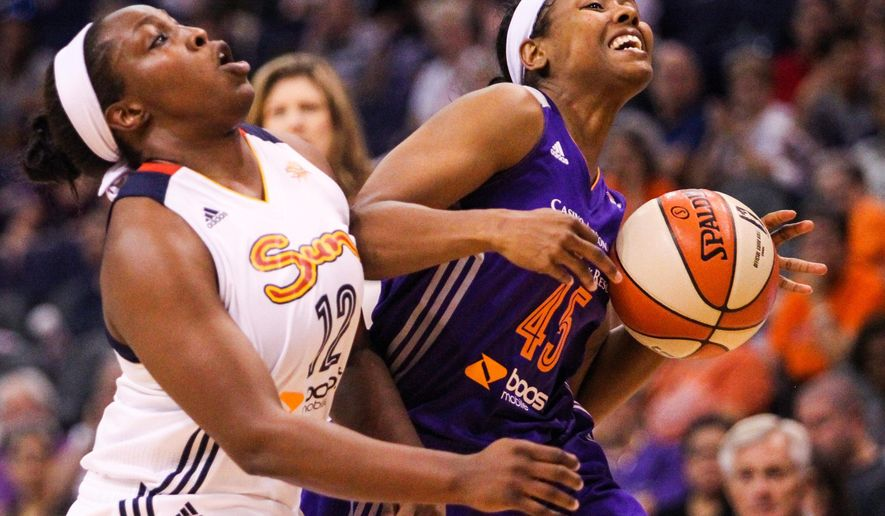 Phoenix Mercury's Noelle Quinn (45) drives against Connecticut Sun's Chelsea Gray (12) during a WNBA basketball game in Phoenix, Ariz., Friday, June 19, 2015.  (Isaac Hale/The Arizona Republic via AP)   MARICOPA COUNTY OUT; MAGS OUT; NO SALES; MANDATORY CREDIT