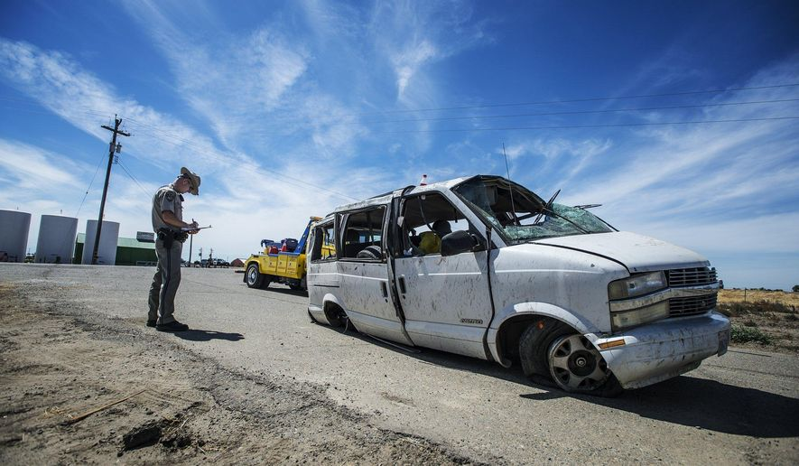The California Highway Patrol investigate the scene of a single vehicle crash State Route 152 in Merced County, Calif., Saturday, June 20, 2015. Authorities said several farmworkers were killed and others hospitalized after a van overturned on the Central California highway. (Andrew Kuhn/Merced Sun-Star via AP) MANDATORY CREDIT