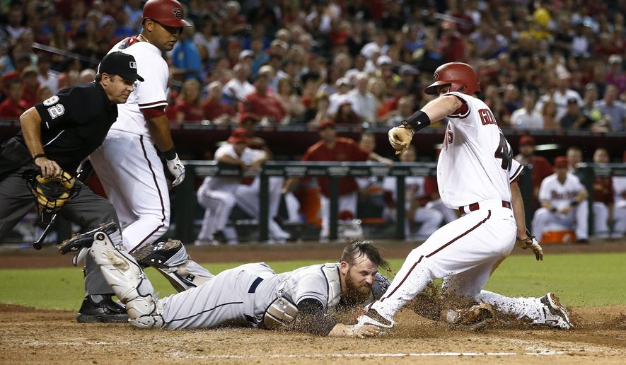 Arizona Diamondbacks' Paul Goldschmidt slides into home as San Diego Padres catcher Derek Norris reaches to tag him during the third inning of a baseball game Friday, June 19, 2015, in Phoenix. Goldschmidt was originally called safe, but after the play was reviewed, was called out. (Rob Schumacher/The Arizona Republic via AP)