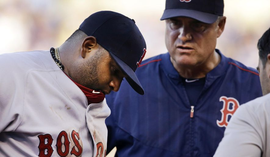 Boston Red Sox third baseman Pablo Sandoval, left, is checked out by a trainer, right, and manager John Farrell, middle, during the fifth inning of a baseball game against the Kansas City Royals at Kauffman Stadium in Kansas City, Mo., Saturday, June 20, 2015. Sandoval left the game. (AP Photo/Orlin Wagner)
