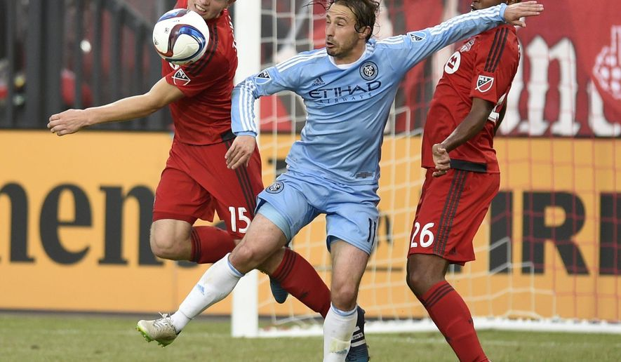 Toronto FC's Eriq Zavaleta (15) and teammate Collen Warner (26) battle against New York City FC's Ned Grabavoy (11) during second-half MLS soccer game action in Toronto, Saturday, June 20, 2015. (Frank Gunn/The Canadian Press via AP) MANDATORY CREDIT