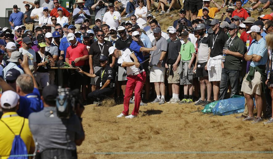 Martin Kaymer, of Germany, hits out of the crowd on the sixth hole during the second round of the U.S. Open golf tournament at Chambers Bay on Friday, June 19, 2015 in University Place, Wash. (AP Photo/Ted S. Warren)