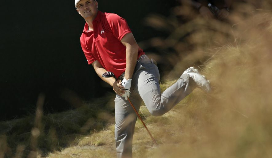 Jordan Spieth watches his tee shot on the seventh hole during the third round of the U.S. Open golf tournament at Chambers Bay on Saturday, June 20, 2015 in University Place, Wash. (AP Photo/Charlie Riedel)