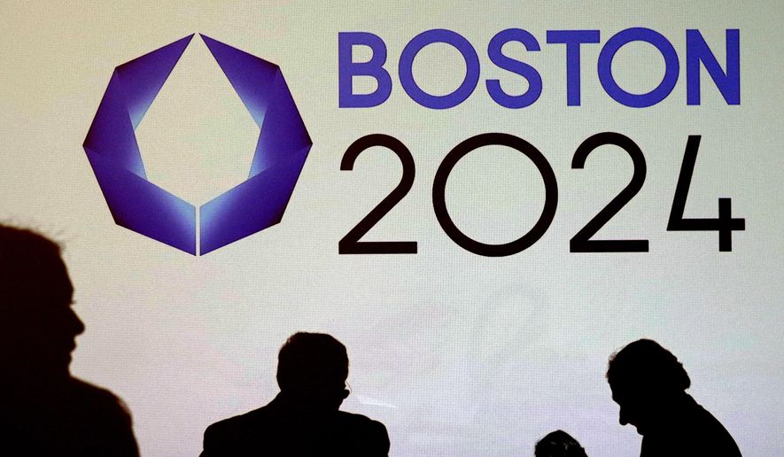 FILE - In this Jan. 21, 2015 file photo, shadows of organizers and reporters pass a video display screen prior to a news conference by organizers of Boston's campaign for the 2024 Summer Olympics in Boston. The city was selected in January by the United States Olympic Committee as the U.S. bid city for the games. But support has sagged in public opinion polls. Organizers of the bid have promised a statewide vote on whether to host the 2024 Summer Games, but unanswered questions remain about the referendum process. (AP Photo/Charles Krupa, File)