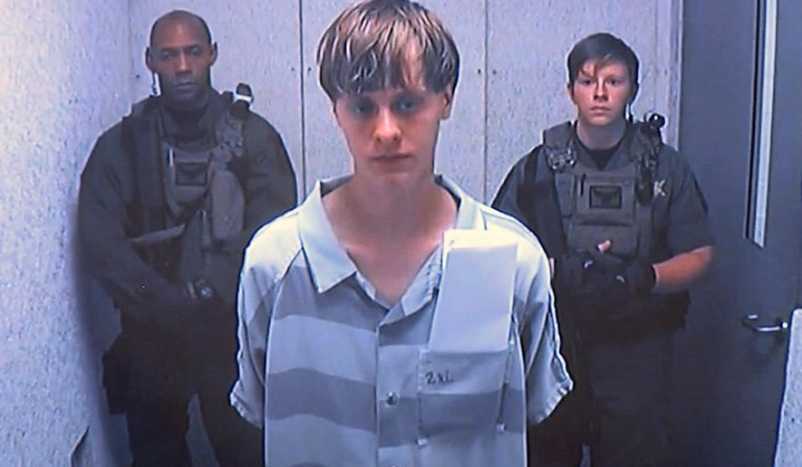 Dylann Roof appears via video before a judge, in Charleston, S.C., Friday, June 19, 2015. The 21-year-old accused of killing nine people inside a black church in Charleston made his first court appearance, with the relatives of all the victims making tearful statements. (Centralized Bond Hearing Court via AP)