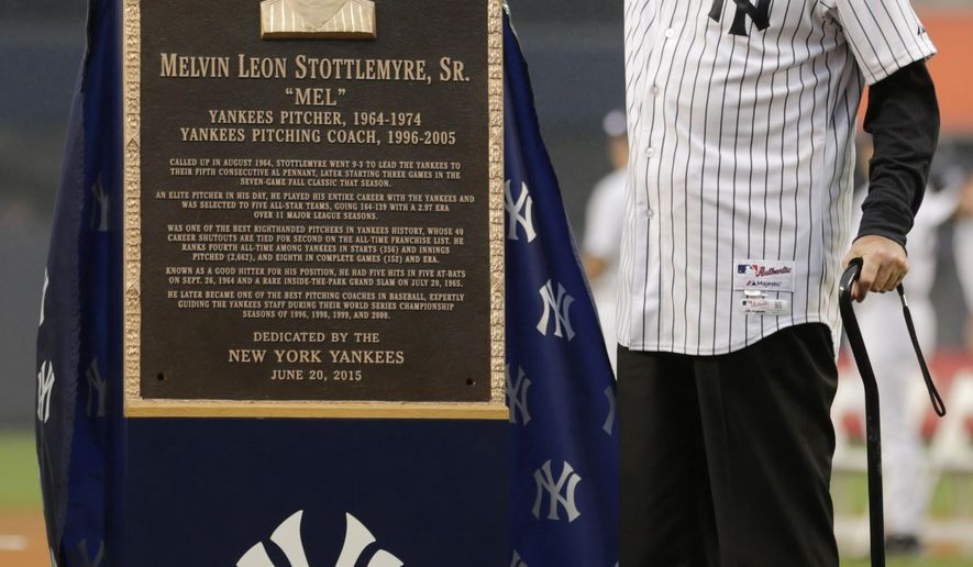 Mel Stottlemyre poses for photographs with a plaque he was awarded during opening ceremonies for the Old-Timers' Day baseball game Saturday, June 20, 2015, at Yankee Stadium in New York. (AP Photo/Frank Franklin II)