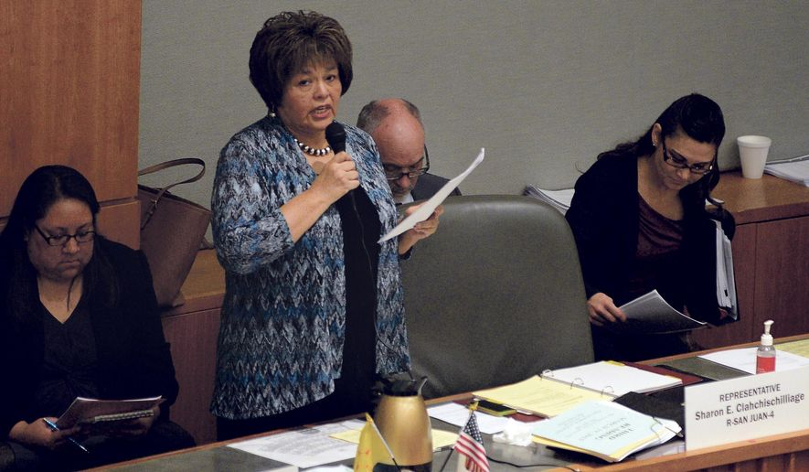"FILE - In this March 19, 2015 file photo, Rep. Sharon Clahchischilliage, R-Kirtland, speaks on the floor of the New Mexico house in Santa Fe, N.M. Officials said this week Rep. Alonzo Baldonado, of Los Lunas, and  Clahchischilliage will join the Republican State Leadership Committee's ""Future Majority Project."" (Clyde Mueller/Santa Fe New Mexican via AP)"
